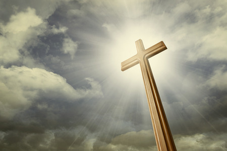 cross light: A cross against shining light on the sky Stock Photo