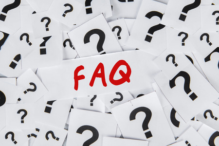 Close up of the word FAQ surrounded with many question marks photo