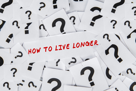 Question about the how to live longer with many question marks on papers