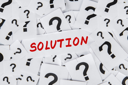 interrogatory: Solution concept with too many question marks on papers Stock Photo
