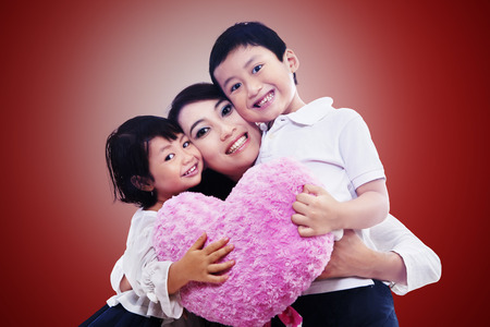 Happy family together on red background photo