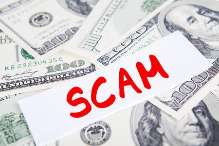 dollar bills: Scam concept: Money dollar bills with scam text