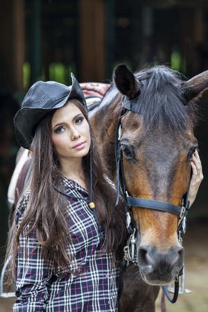 girl on horse: Beautiful young woman and her horse