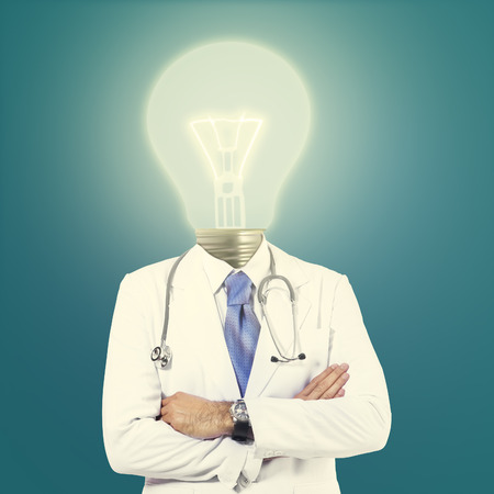 Doctor with lamp-head isolated on different backgrounds photo