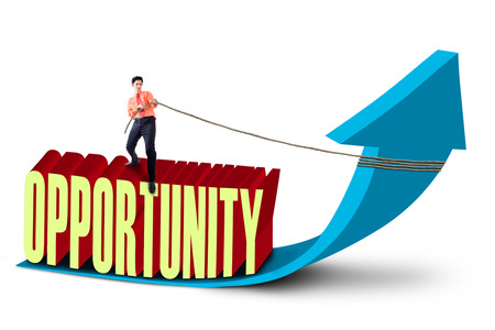 Businessman is pulling opportunity concept on white background photo