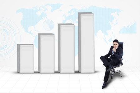 finacial: Young confident businessman with chart on world map background  Stock Photo