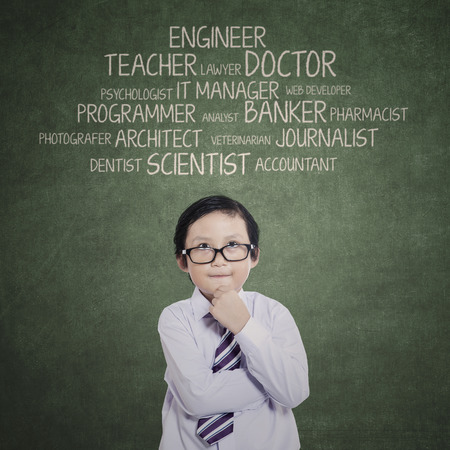 accomplishment: Portrait of young boy thinking his aspirations  Stock Photo