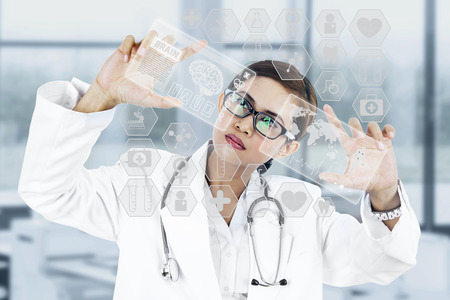 Image of young woman doctor. Concept of modern technology photo