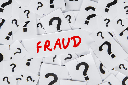 crime solving: The word of Fraud surrounded by question marks