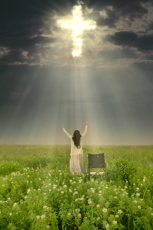 healed: Woman with wheelchair is being healed by God. Shot in meadow Stock Photo