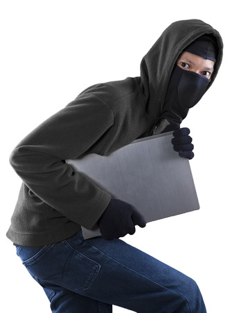 housebreaking: Portrait of a thief stealing a laptop computer Stock Photo