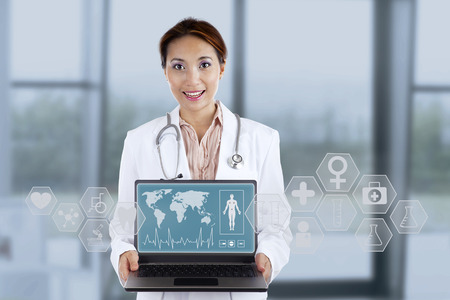 Female doctor showing medical interface with help of modern technology photo