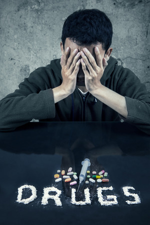 illegal substance: Portrait of a young drug user Stock Photo
