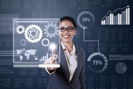 controlling: Business woman touching virtual screen of controlling system