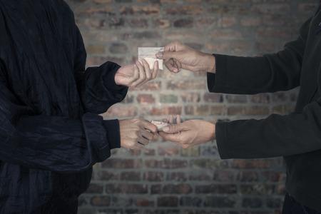 methamphetamine: Drug dealer taking money for heroine Stock Photo