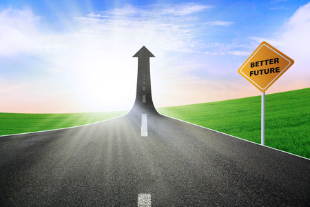 A road turning into an arrow rising upward with a road sign of better future, symbolizing the improvement of better future photo