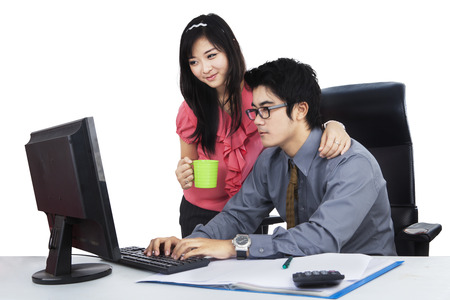 Portrait of businessman with his secretary working isolated over white photo