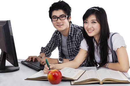Asian students studying together isolated on white background photo