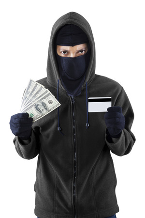 thievery: Portrait of a burglar with credit card and money on his hand Stock Photo