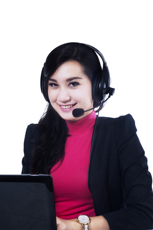 Friendly customer service working at her desk photo