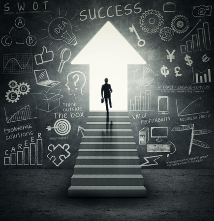 Way to success  Businessman walking on stairways to an upward  arrow door with  the success doodle on the wall photo