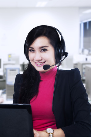 Beautiful customer service smiling in her office photo