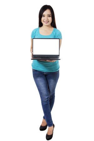laptop stand: Beautiful woman showing a laptop on white background