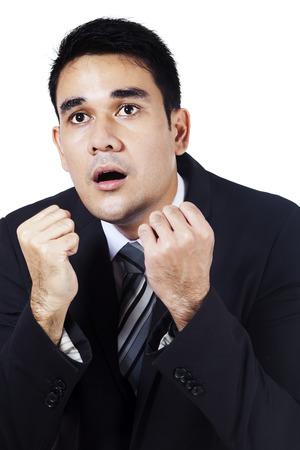 Funny face expression of amazed businessman. isolated on white background photo