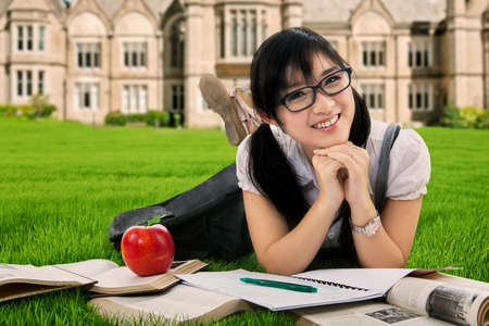 field study: Cute Asian student studying outdoor