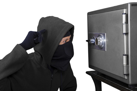 Burglar trying to open a safety box photo