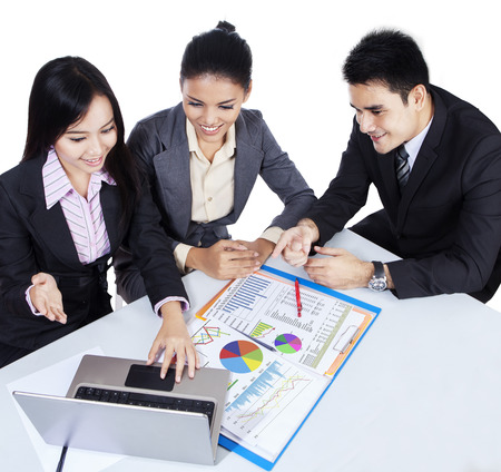 filipino people: Three asian business team working with laptop. isolated on white background Stock Photo