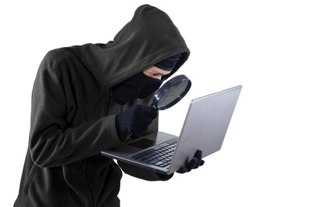 criminal activity: Portrait of hacker isolated on white background Stock Photo