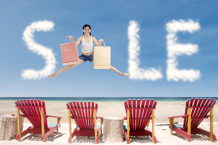 Summer sale cloud with girl jumping over beach chairs photo