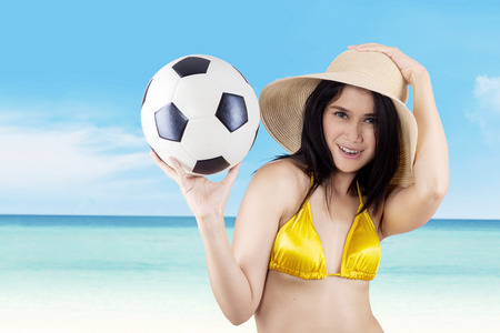 Attractive sexy woman soccer fans holding a soccer ball. photo