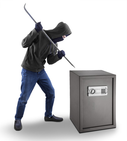 burglar protection: Burglar with a crowbar is trying to open a safety box isolated over white