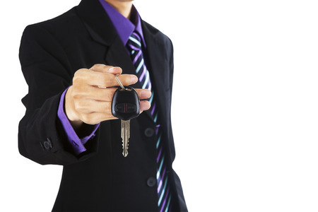 Young successful businessman offering a car key photo