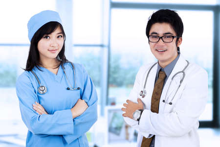 Portrait of male doctor and a female surgeon in pose. shooting at hospital photo