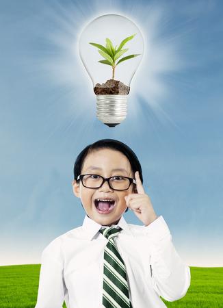 Little boy having an idea with ecological concept photo