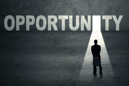 financial freedom: Businessman standing in front of opportunity door Stock Photo