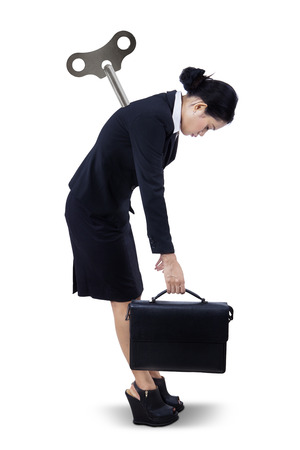 Businesswoman with steer like a doll standing on white background photo