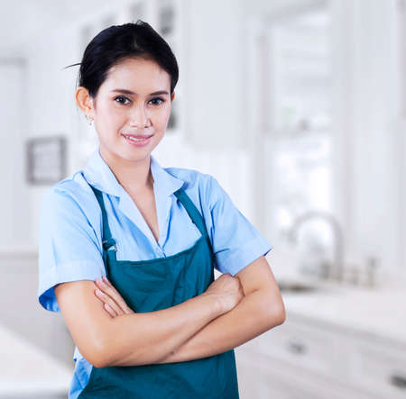 Portrait of female housekeeper. shooting in the kithcen photo