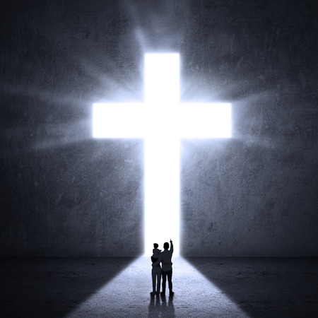 jesus cross: Silhouette of a family looking at the Cross of Jesus Stock Photo