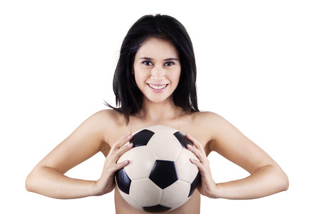 Young sexy woman holding a soccer ball. isolated on white photo