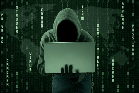 cyber crime: Hacker typing on a laptop with binary code background