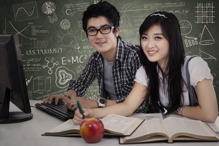 assignment: Young Asian students studying together in class Stock Photo