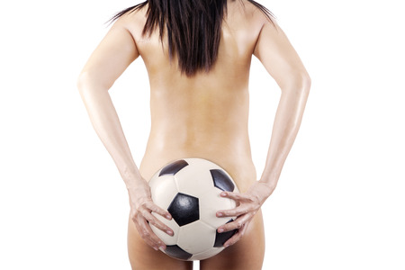 nude pretty girl: Womans Sexy Backside Holding a Soccer Ball. isolated on white background Stock Photo