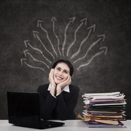 Image of businesswoman with arrows to represent mind map photo