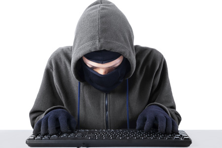 Computer hacker - Male thief stealing data from computer. isolated on white background photo
