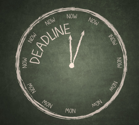 time out: Deadline writing and a clock on a blackboard