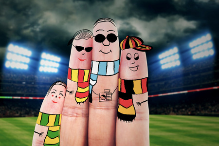 Fingers gesturing as family members that travels at the soccer championship photo